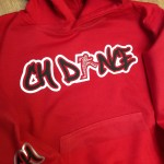 Red hoodie with Dance School Logo on in silver and black including a rhinestone dancer