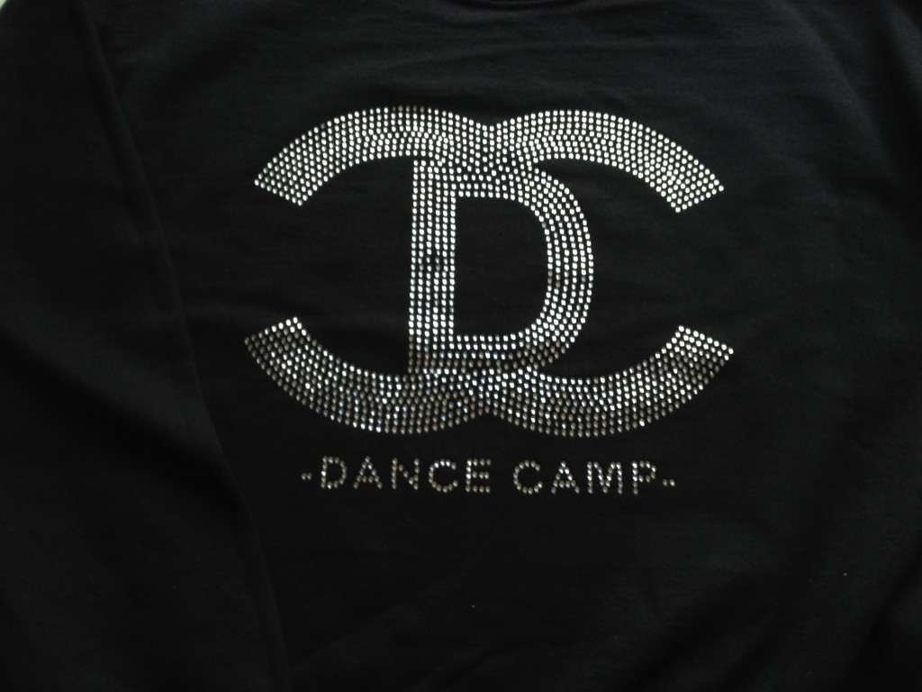 A Crystal Rhinestone Logo on a Black T shirt
