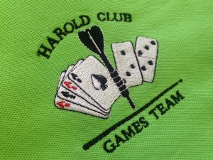Embroidery Patch for Harold Club Games Team on a Green Polo Shirt